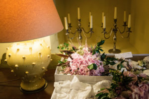 Bridal flowers on sideboard with candles