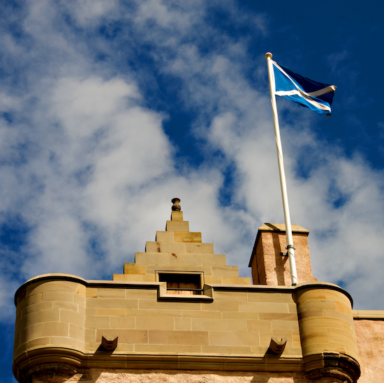 Castle ramparts and saltire flag